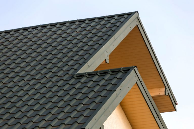close-up-detail-new-modern-house-top-with-shingled-green-roof