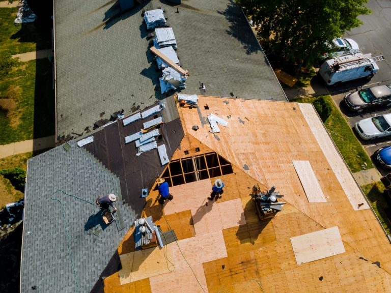 removal-old-roof-replacement-roofs-with-new-roof-shingle-being-applied-home-roof-construction