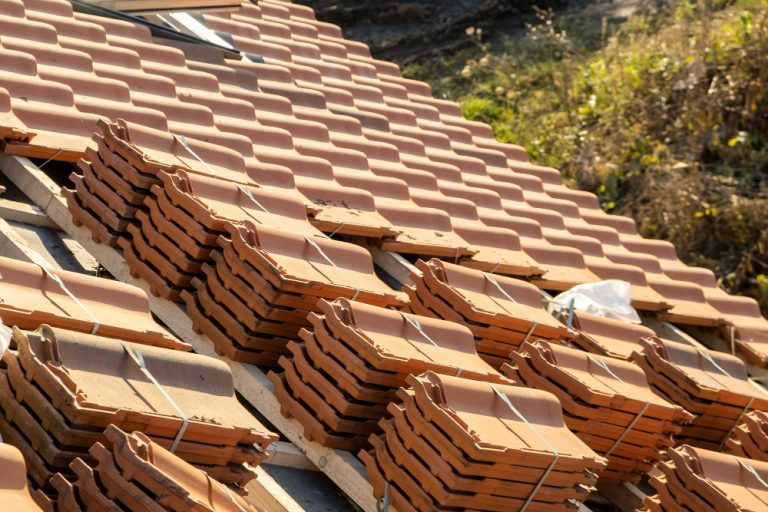 stacks-yellow-ceramic-roofing-tiles-covering-residential-building-roof-construction